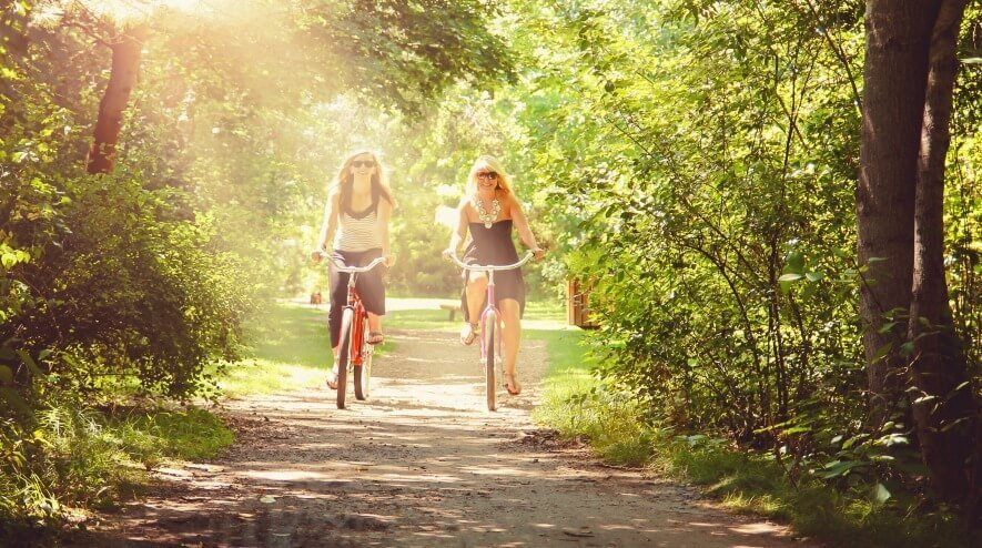 Women riding bikes on the Boise Greenbelt